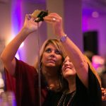 new orleans corporate event attendees taking a selfie
