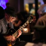 guitarist playing at new orleans corporate party
