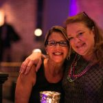 women smiling at camera at new orleans corporate party
