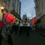 second line parade on Bourbon street at New Orleans corporate event